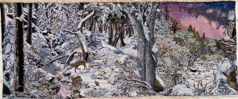 Images of the forest covered in snow, deer eating.